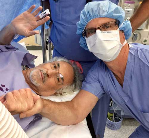 Dr. Yunis with Patient after surgery